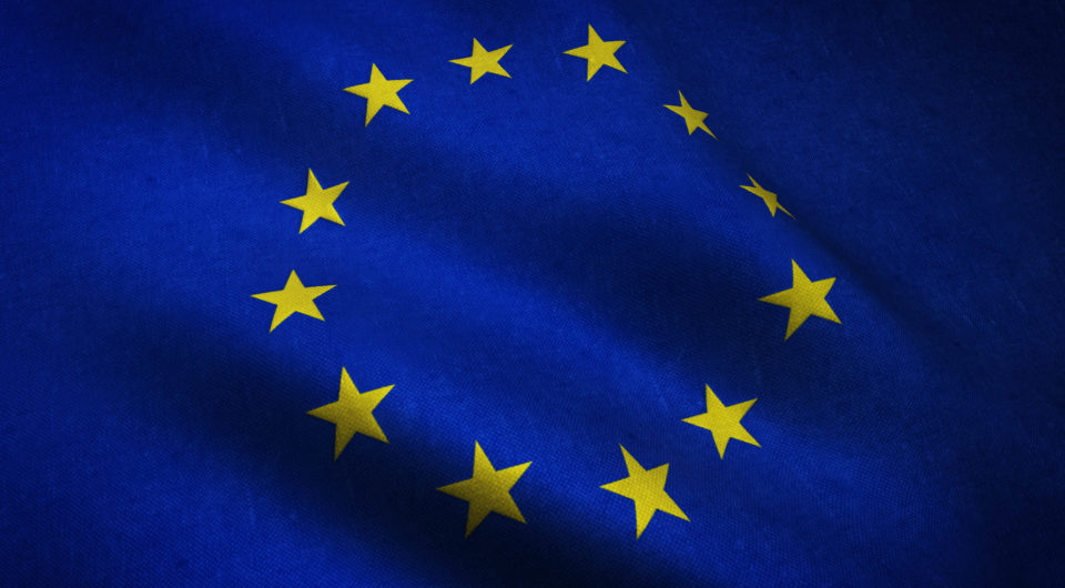 Closeup shot of realistic waving flag of Europe with interesting textures